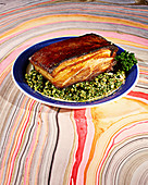 Pork belly with kale hazelnut pesto