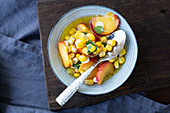 Peach and corn salsa to be served with fish