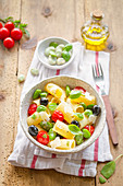 Rigatoni pasta with broad beans, tomatoes and olives