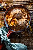 Apricot dumplings with Mozartkugel