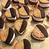 Heart-Shaped S'mores on Baking Sheet with Parchment Paper