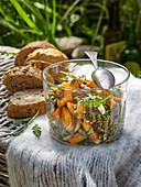 Light sweet potatoes salad with lentils and garden vegetables