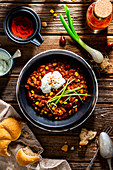 Black pudding chilli with runner beans and corn