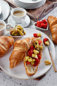 Breakfast croissant with rhubarb mousse and strawberries