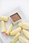 Banana coffee cream (molecular cuisine) with apple wedges