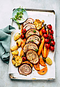 Rolled pork crust roast with vegetables