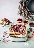 Christmas tiramisu with pomegranate seeds and candy canes