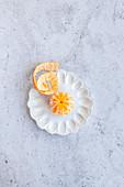 Peeled honey gold tangerine on a decorative ceramic plate