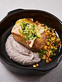 Potato kumpir with lentil salad and black bean hummus
