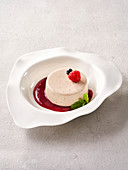Ginger panna cotta with forest berry sauce (vegan)