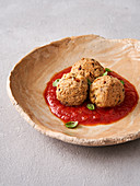 Sesame Tofu balls with tomato sauce (vegan)