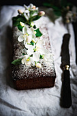 Apple loaf cake decorated with apple tree blossoms