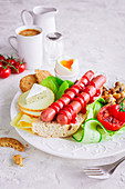 Breakfast with sausages, tomato, cheese and soft-boiled egg