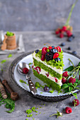 Forest moss cake with cream and summer fruit