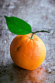 Orange fruit with a leaf