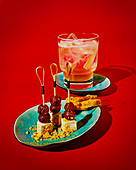 Non-alcoholic gin and tonic with rhubarb and fennel syrup, plus vegan cheese with grilled grapes