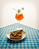 Non-alcoholic herbal liqueur with rose lime and cucumber syrup, with vegan bread sticks