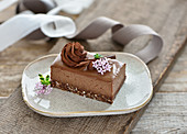 Raw vegan chocolate mousse cake with oat and date crust and creamy ganache