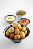 Boiled potatoes with various sauces and dips