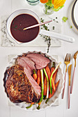 Braised leg of lamb with vegetables and sauce
