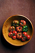 Different tomatoes in earthenware bowl