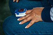 Pulse oximeter on a patient's hand