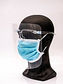Bust wearing a face visor and face mask