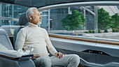 Man looking out of the window of an autonomous car