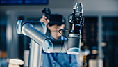 Engineer controlling a robotic arm with a VR headset