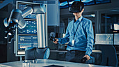 Engineer controlling a robotic arm using virtual reality