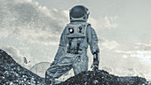 Astronaut looking around while standing on a hill