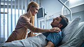 Wife visiting her recovering husband in the hospital