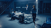 Automotive engineers working on an electric car