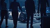 Automobile design engineers entering an automotive facility
