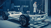 Automotive engineers and scientists working on electric car
