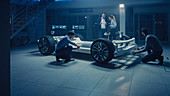 Automotive engineers designing an electric car