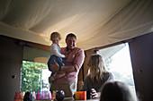 Family in a yurt cabin