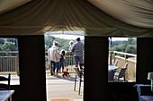 Family on a yurt tent balcony