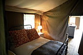 Bed and lamp in luxury camping yurt