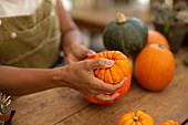 Woman arranging a pumpkin display