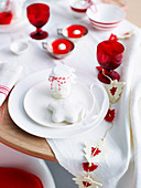 Christmas table with red and white tablecloth and hostess gift
