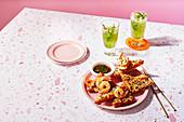 Pork and sugarcane skewers, Prawn toasts, Lemongrass and tamarind iced tea