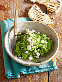 Pea dip with feta cheese and bread loaf