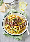 Pasta with beef meat and rosemary