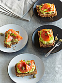 Open sandwiches with avocado, salmon and capers
