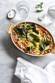 A spicy vegetable casserole on a marble backdrop