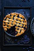 Blueberry lattic pie dessert on a baking tray