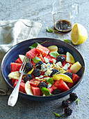 Melon salad with blackberries and pears