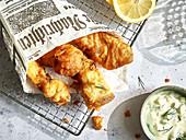 Fried fish in a newspaper cone
