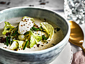 Cream of cauliflower soup with greens